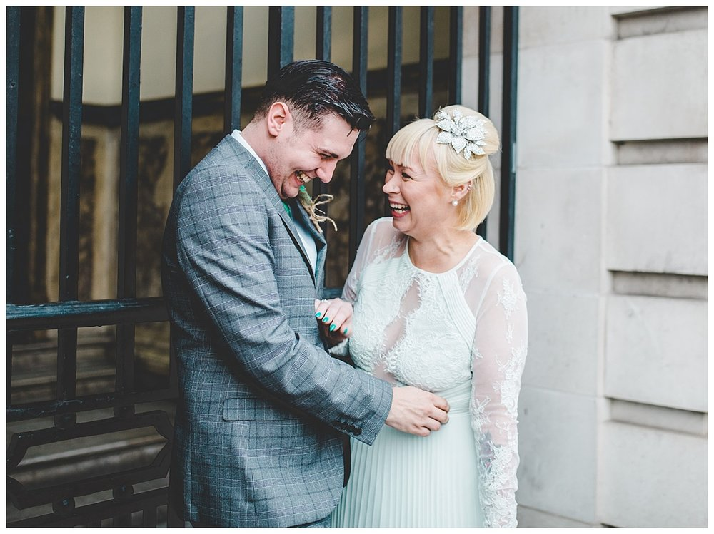 relaxed bride and groom - outside Stockport Town Hall