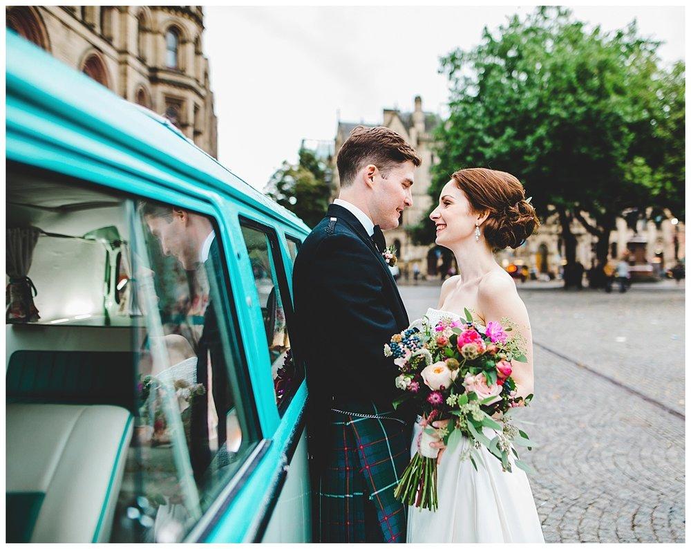 bride and groom on camper van.