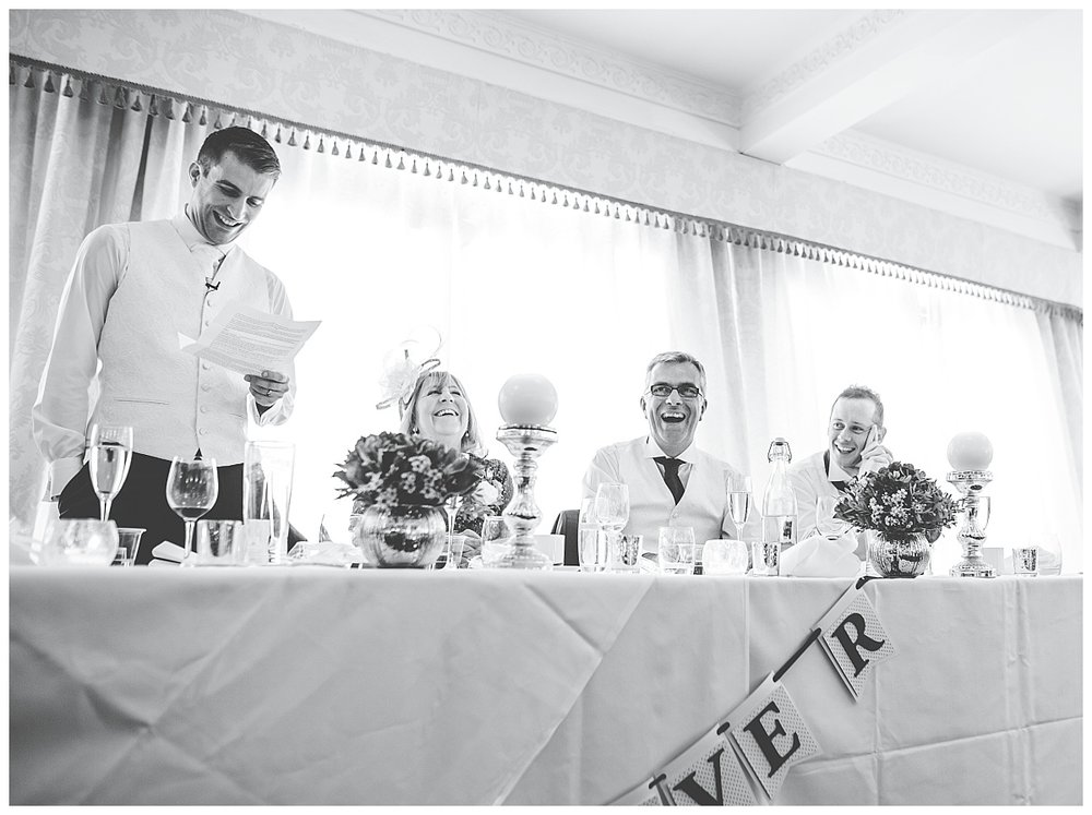 documentary wedding photographer in Cheshire - groom gives his speech