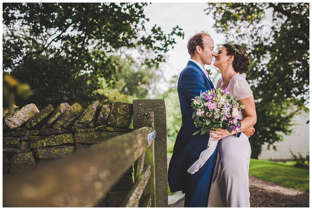 rural farm wedding in  Lancashire - bride looking amazing in her boho dress