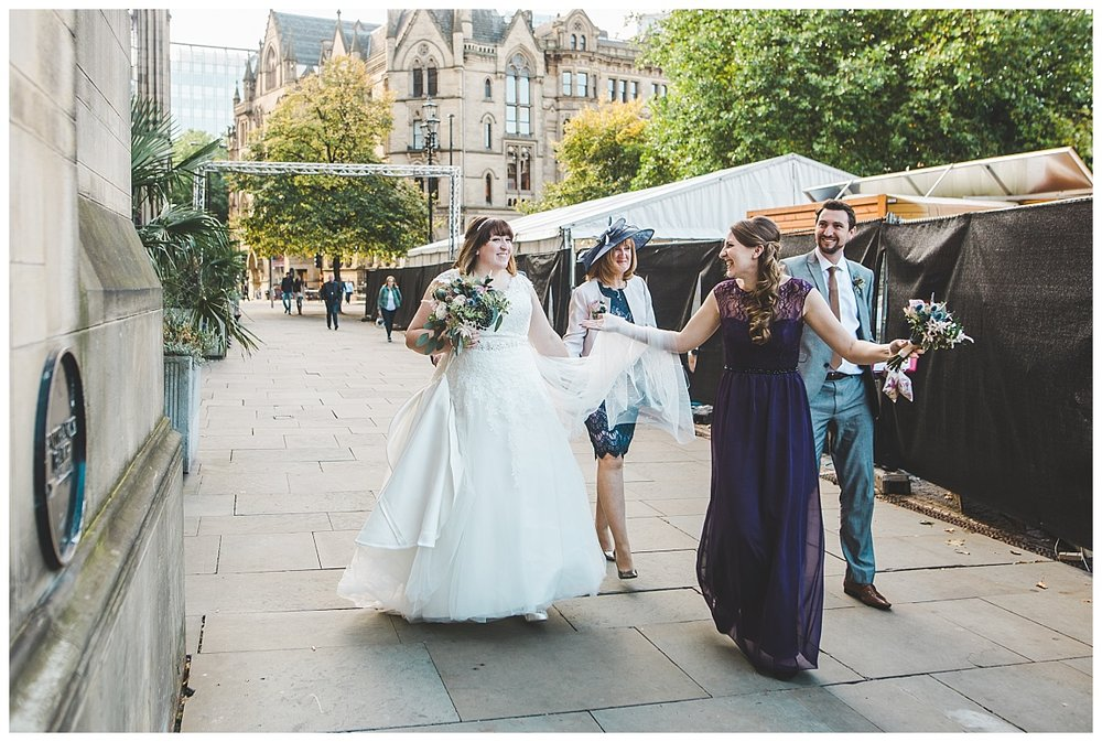 bride walking into manchester town hall wedding