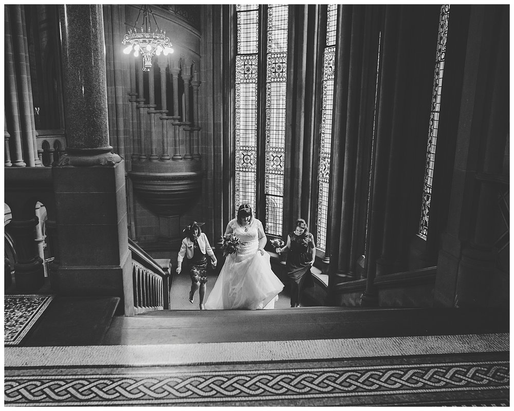manchester town hall - bride walking up the stairs to her ceremony