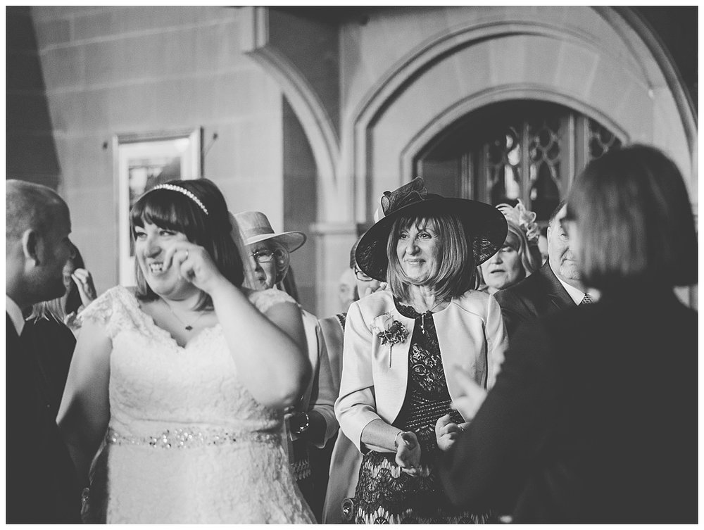 authentic and natural images of bride's mother during manchester wedding ceremony