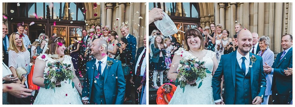manchester wedding photographer - bride and groom walk through confetti