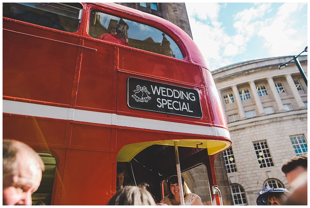 guests getting on the wedding bus