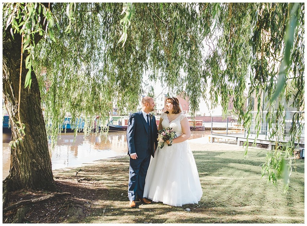 wedding photographer in manchester - pictures of the bride and groom in castlefield