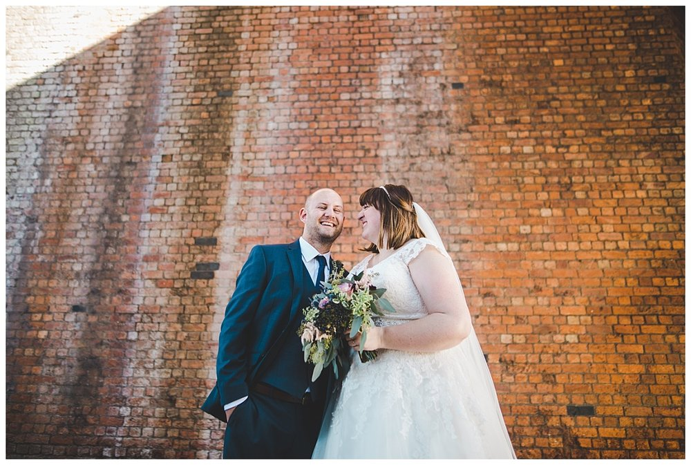 creative image of the bride and groom in castlefield - wedding photography in manchester city centre