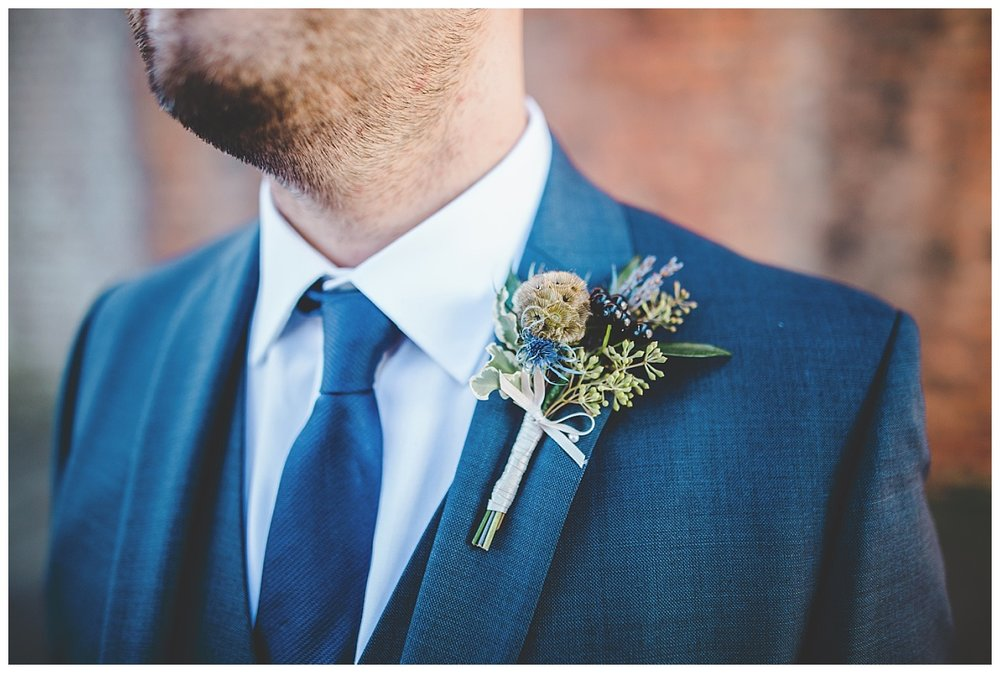 close up of the grooms buttonhole