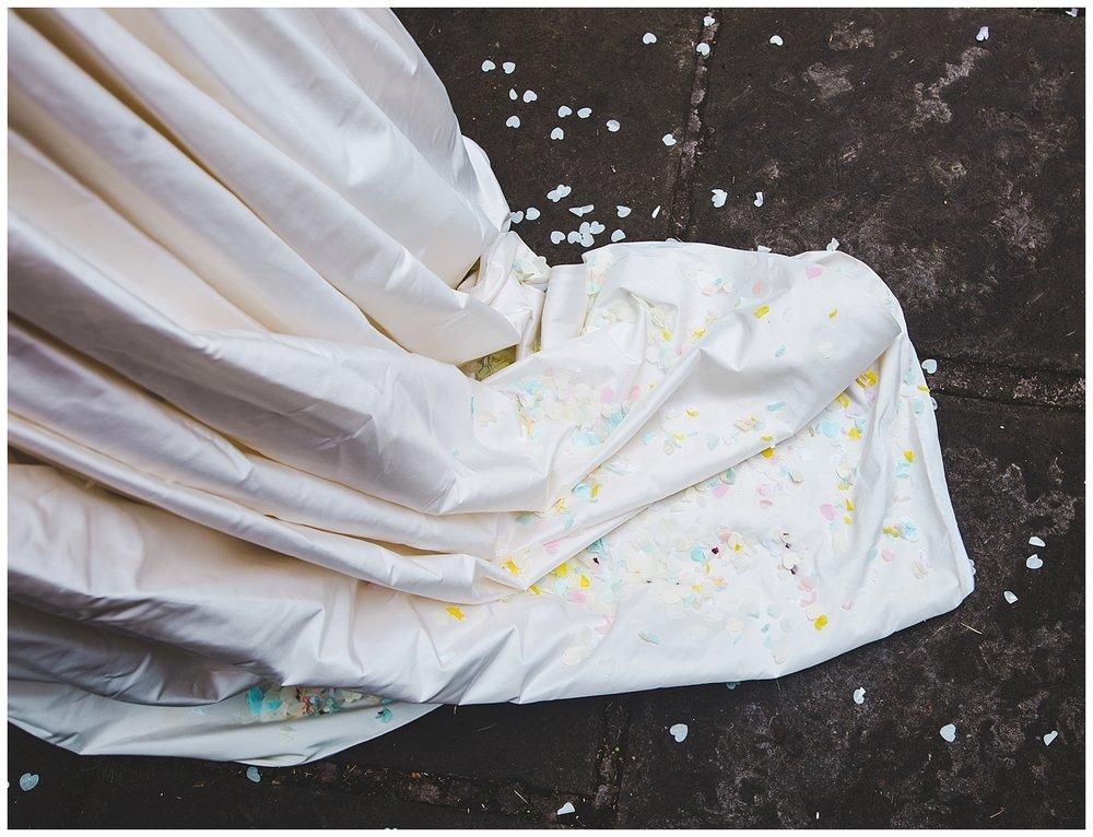 confetti on the bride's dress