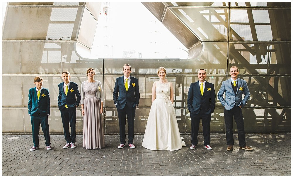 bride and groomsmen group shot - the lowry centre in manchester