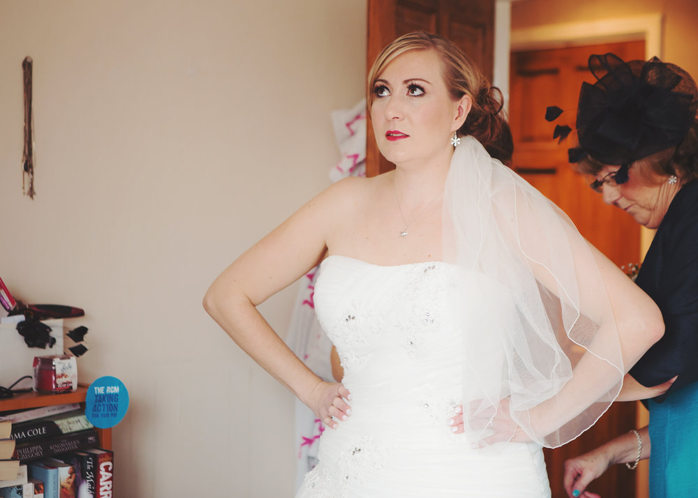 nervously getting dressed - winter wedding in the north west