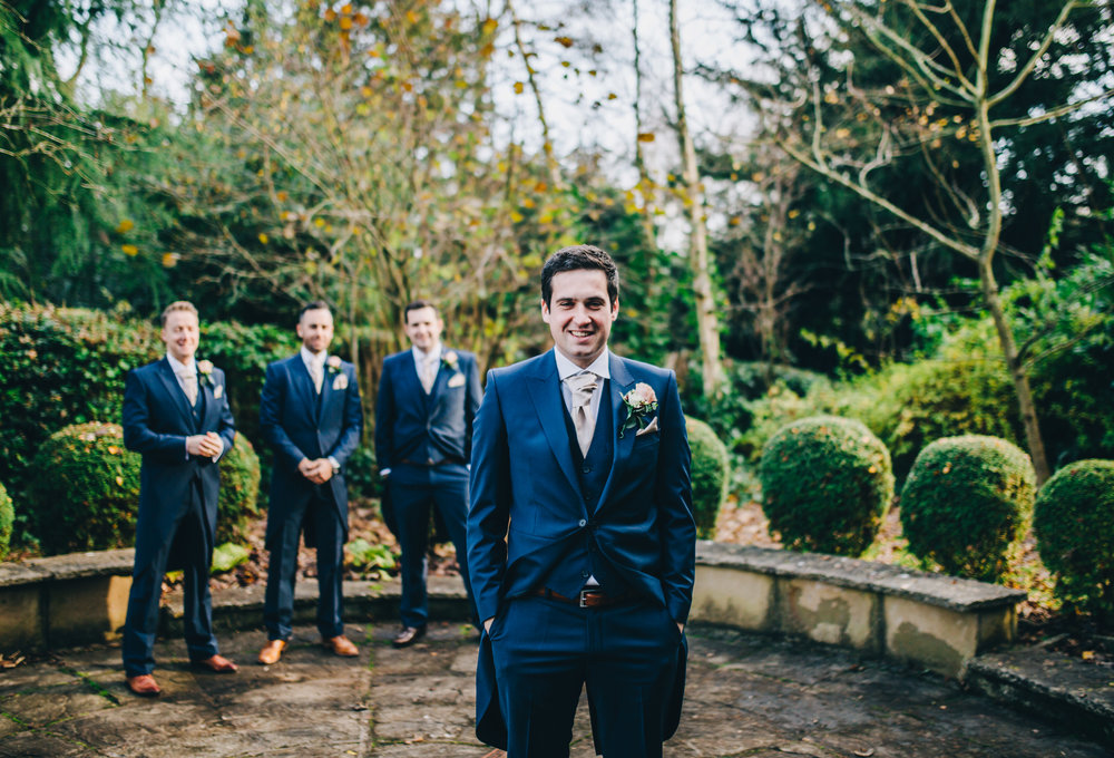 relaxed group shots - groom with his groomsmen outside church in shropshire