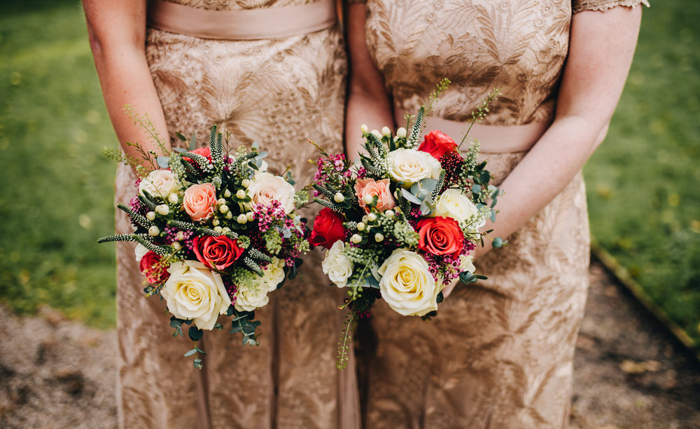 winter wedding inspiration - gold dresses and winter bouquets