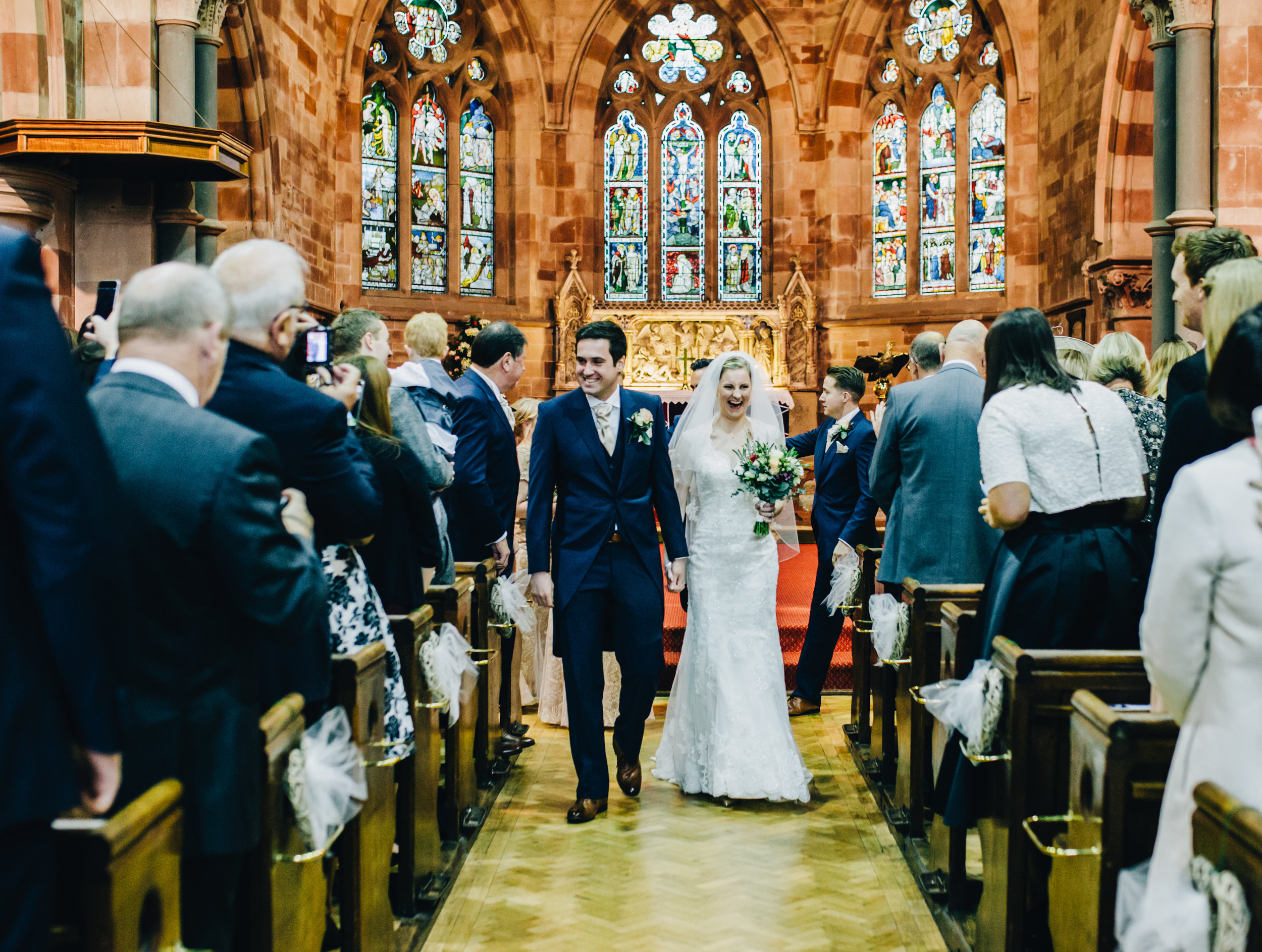newlyweds walk down the aisle - shropshire wedding
