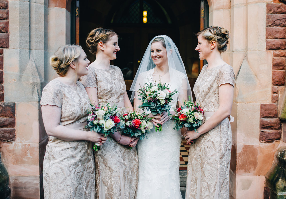 bride and her bridesmaids outside the church in meols brace - north west wedding photographer
