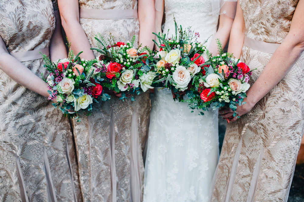 winter wedding inspiration - bridesmaids with gold dresses