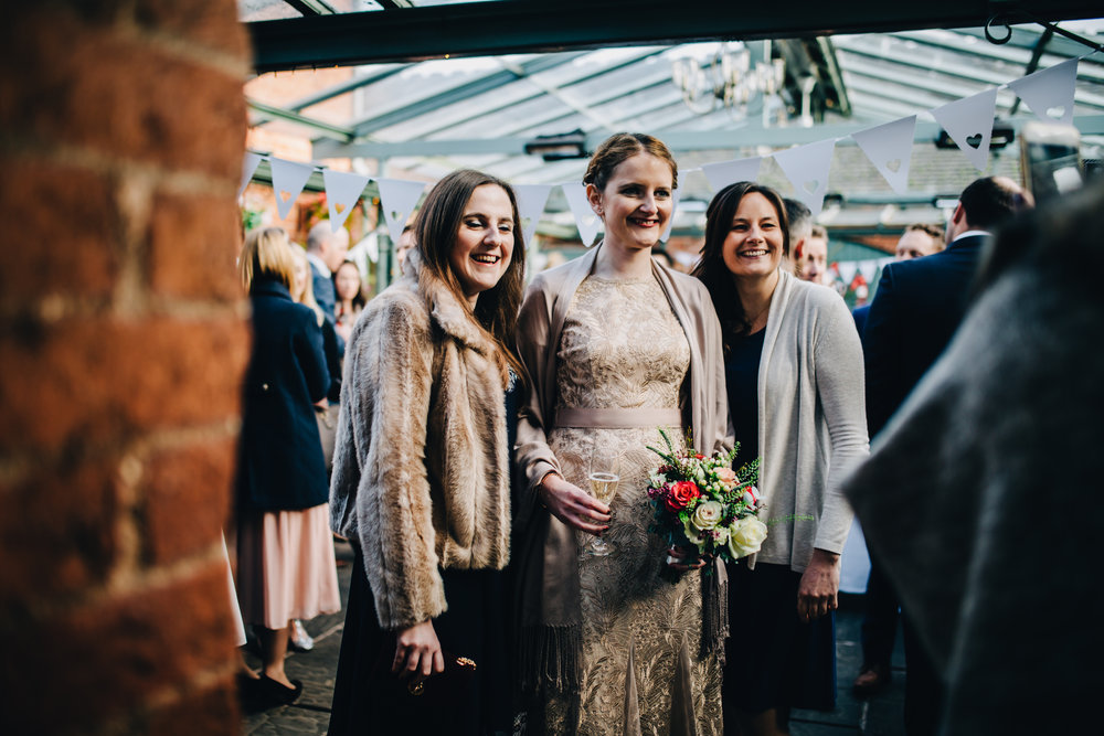 documentary images of guests relaxed and drinking - north west wedding photographer