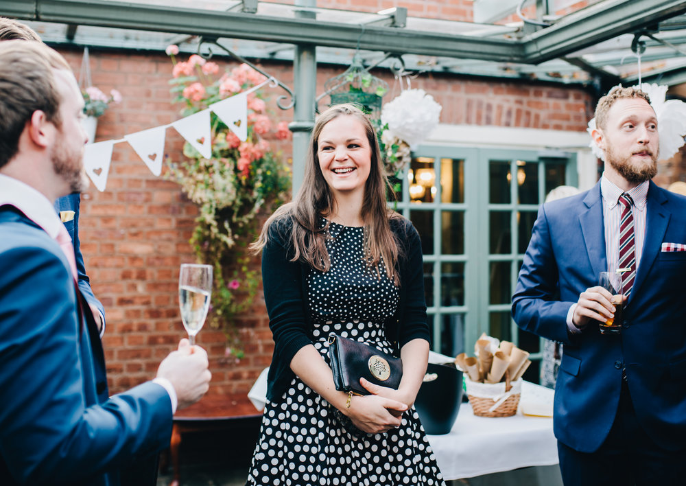 smiling guest enjoying the wedding reception at mytton and mermaid