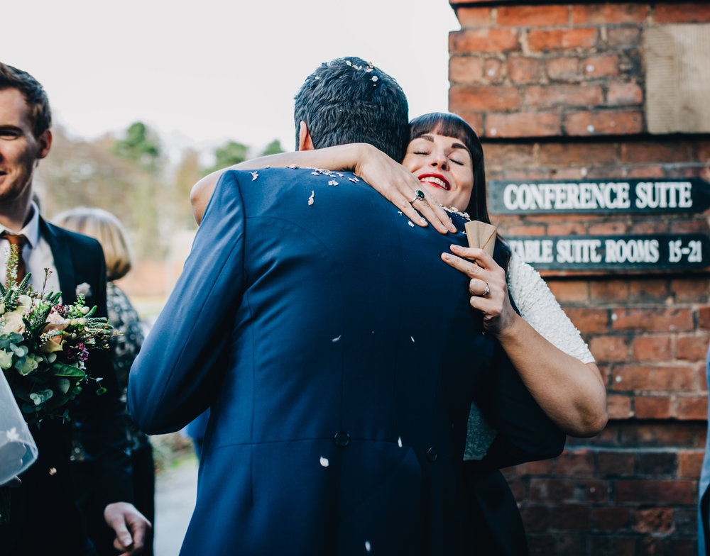 guests hugging - documentary wedding photography