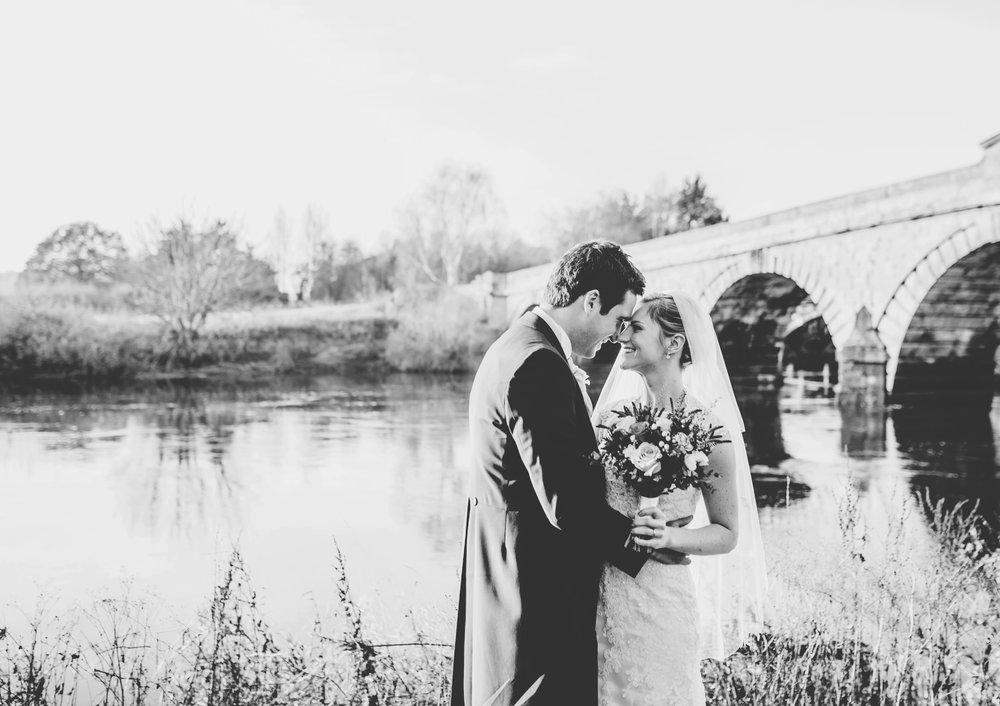 cheshire wedding photography - bride and groom by the river