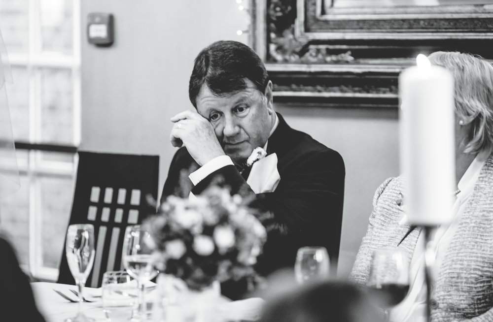 dad wipes away a tear during speeches - capturing the emotion in wedding images - cheshire wedding photographer