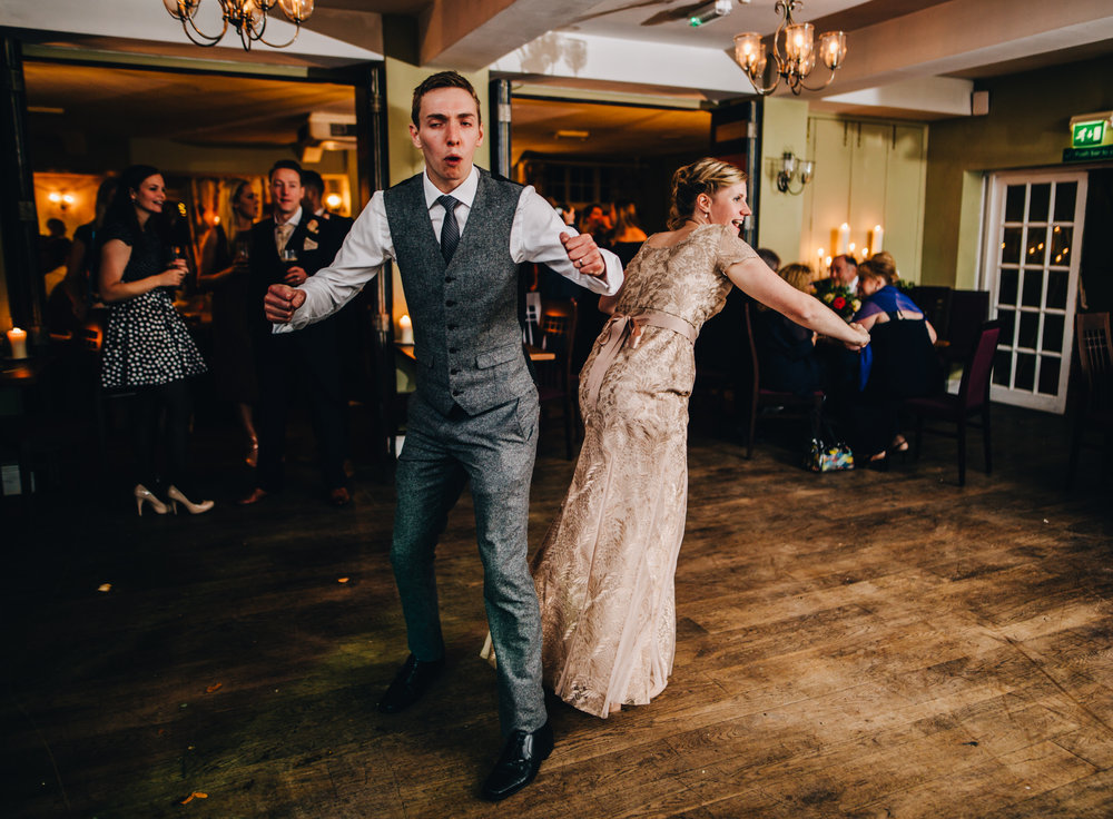 fun dancing wedding photographs