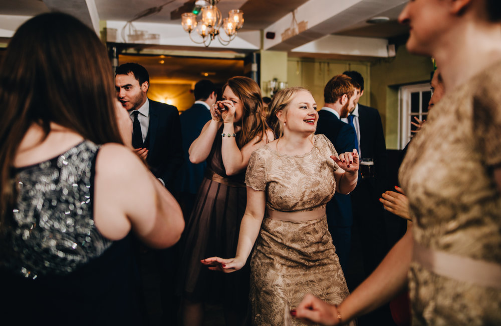 bridesmaids dancing - documentary wedding photography in cheshire