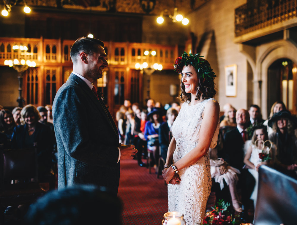 manchester wedding photographer - couple smile at each other during the wedding ceremony