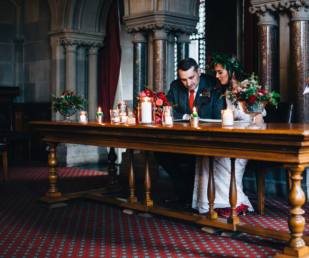 bride and groom signing the marriage register - manchester town hall wedding ceremony