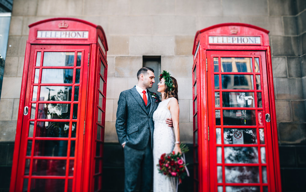 cool and modern wedding photography in manchester - bride and groom next to red phone boxes