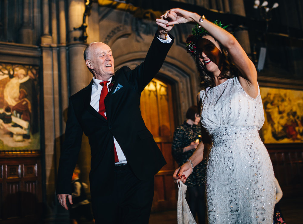 wedding photographer in manchester - bride dances with her father