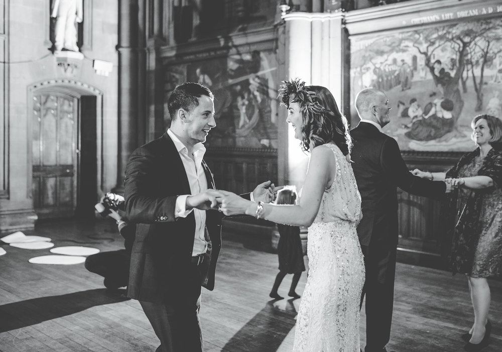 bride dances with a guest at her Manchester town hall wedding