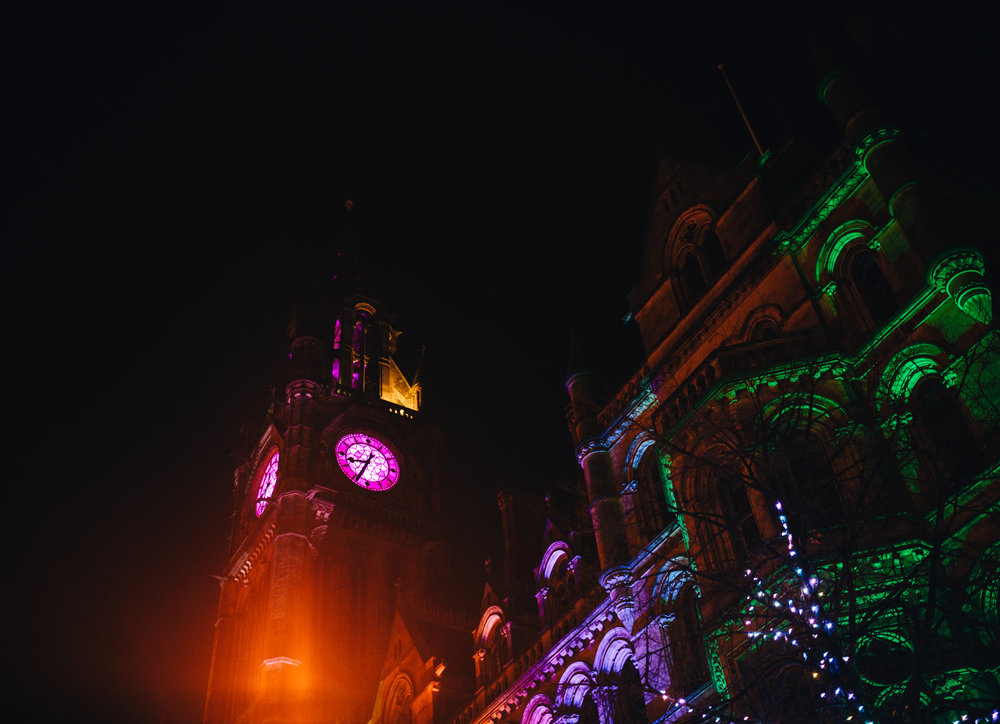 exterior shot of manchester town hall lit up at night