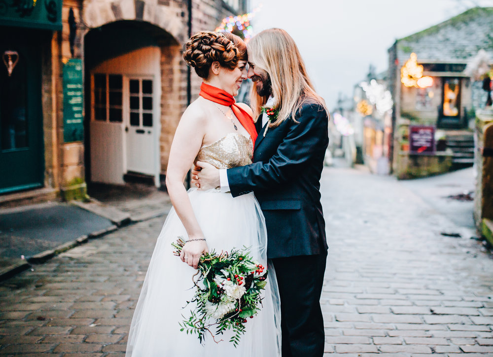 bride and groom on the historic streets of haworth