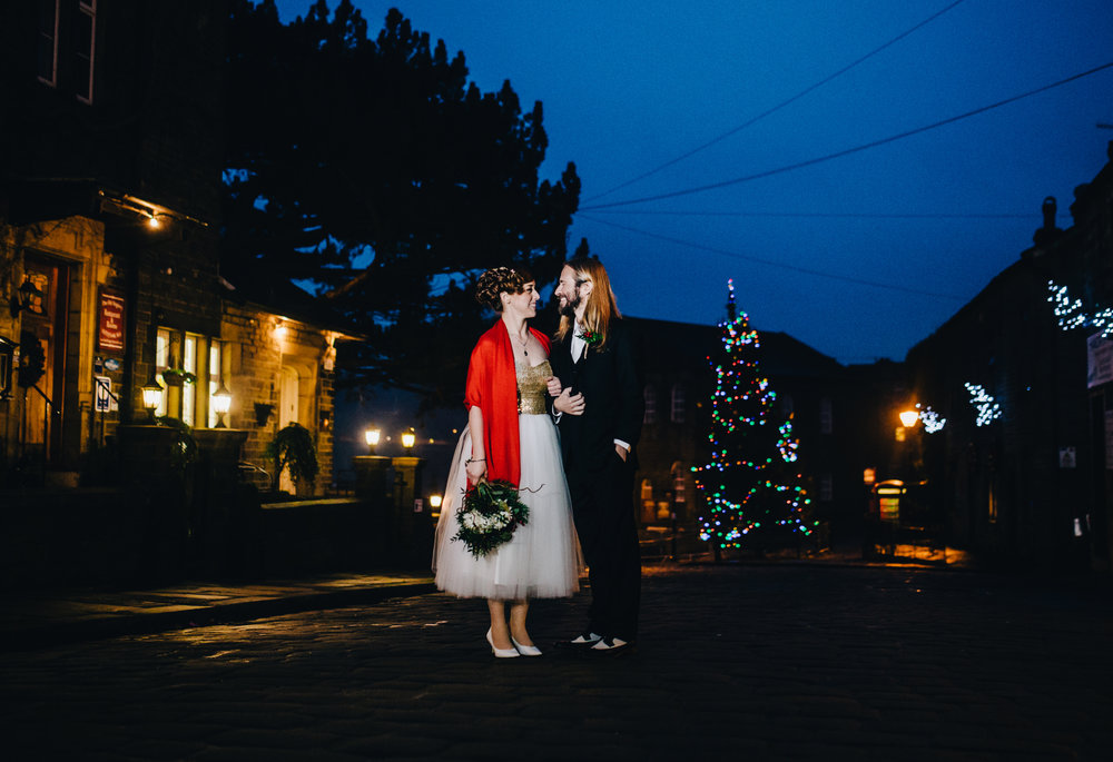 christmas wedding in Haworth - bride and groom on the high street