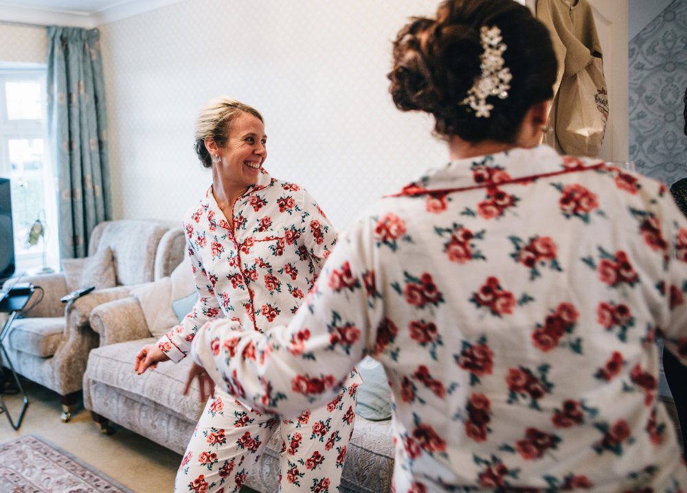 bridesmaids dancing around the living room before the wedding