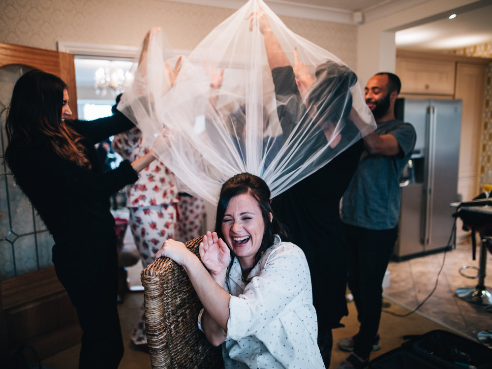 bride having her hair done - documentary wedding images
