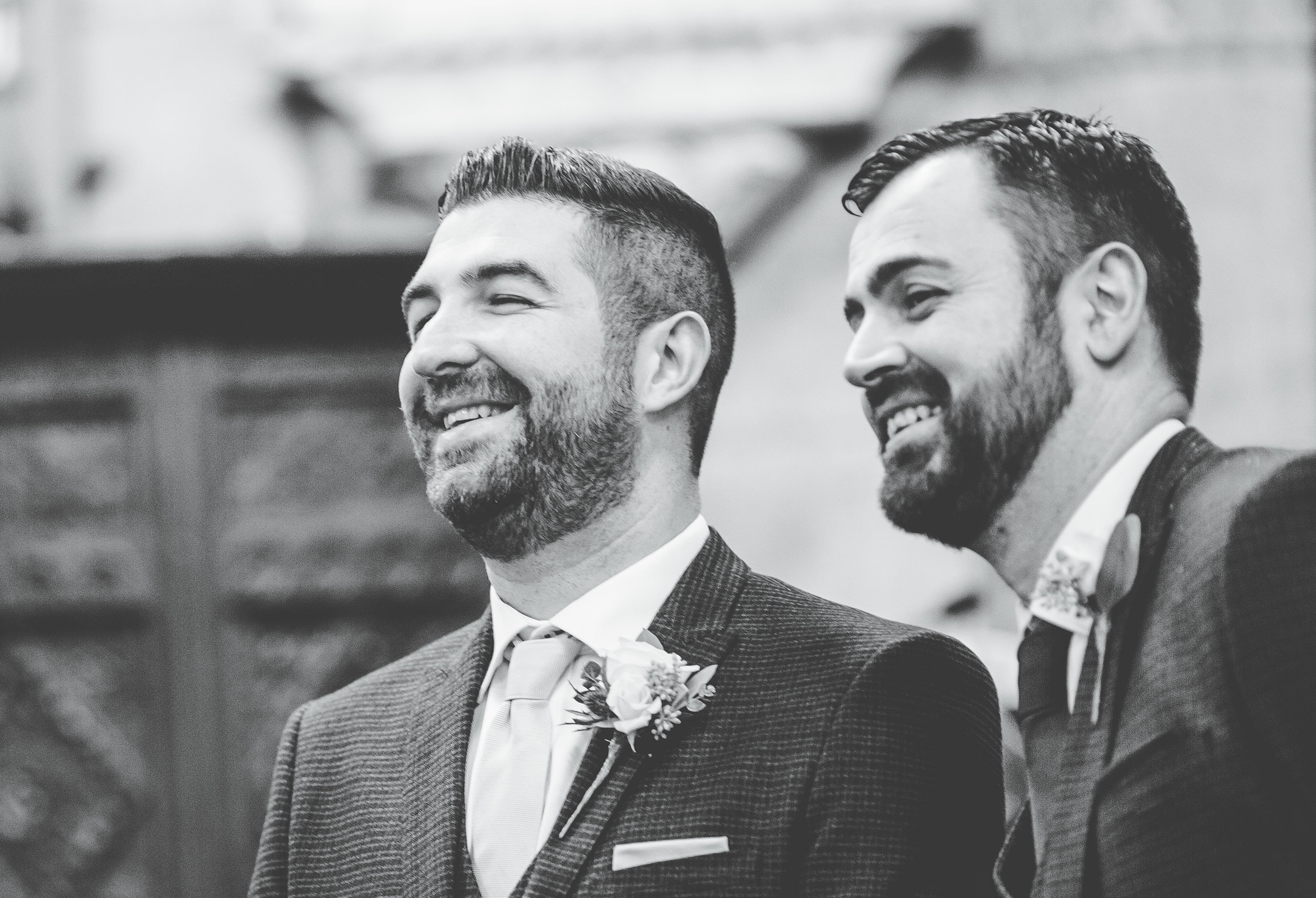 groom laughs with guests - lancashire wedding photography