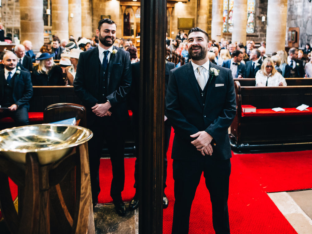 groom awaits the arrival of his bride = wedding photographer in manchester