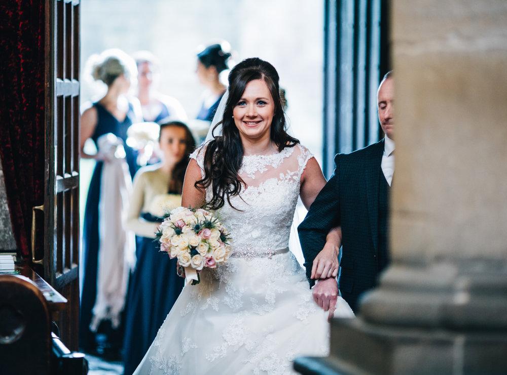 bride enters church - smiling