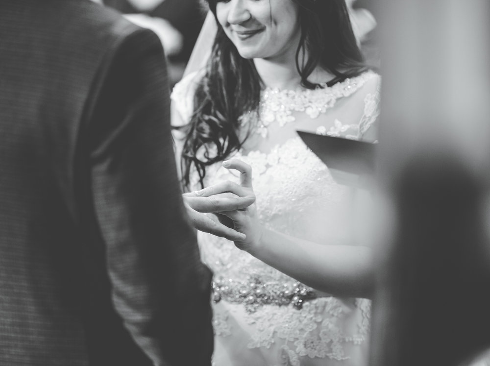 close up of ring exchange - black and white wedding photography