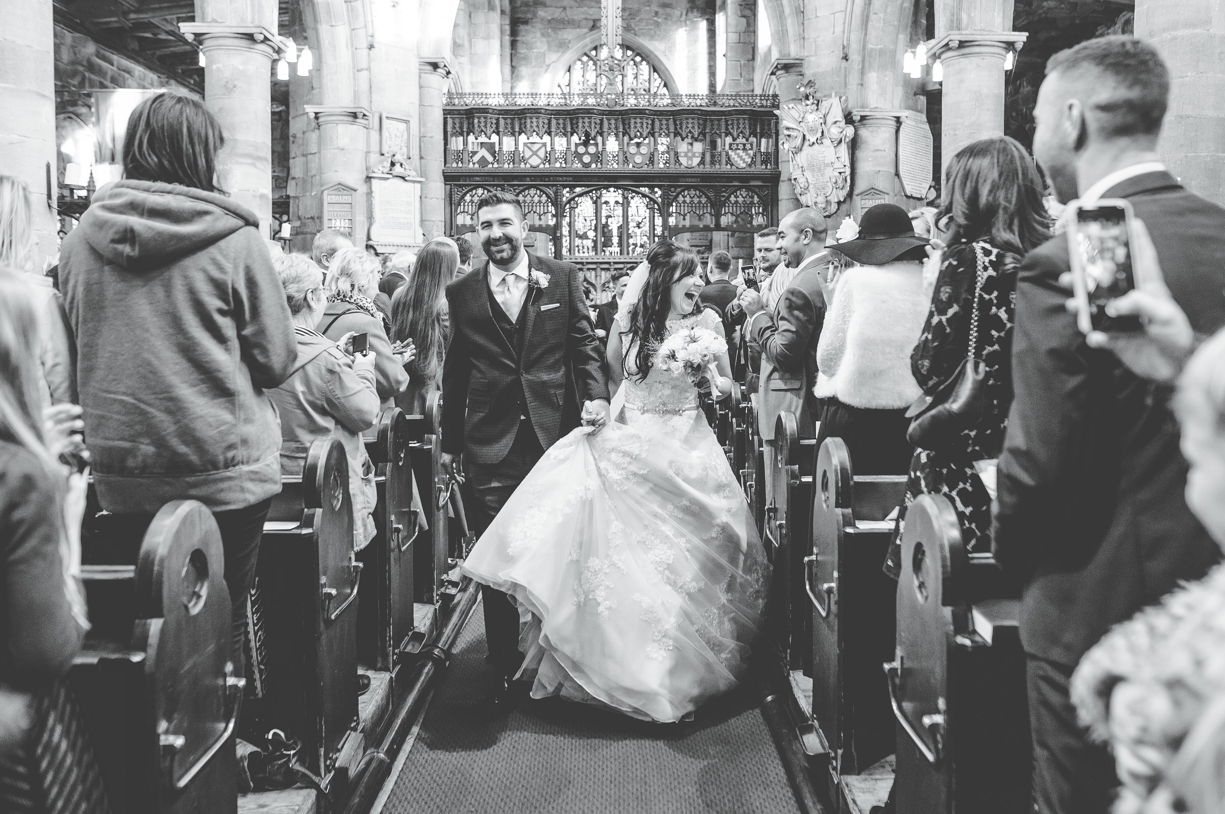 walking down the aisle in church - wedding photographer Lancashire
