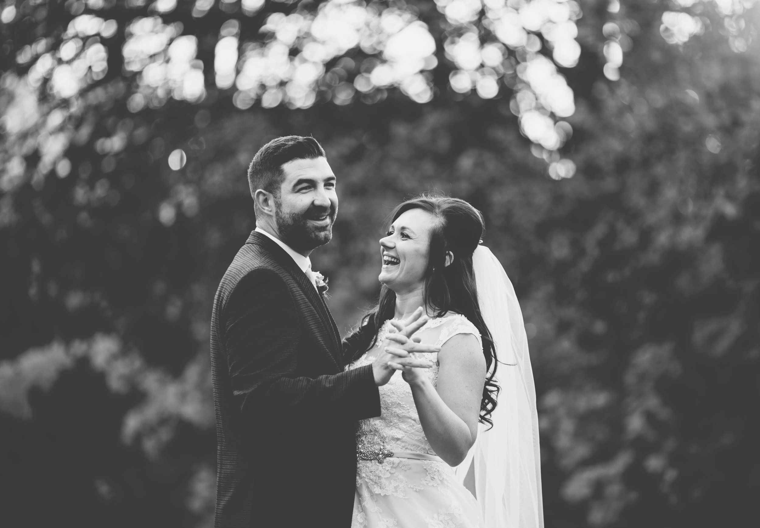 couples laugh in the grounds of Ashfield House wedding