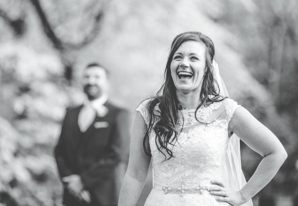 bride laughing - groom looking on