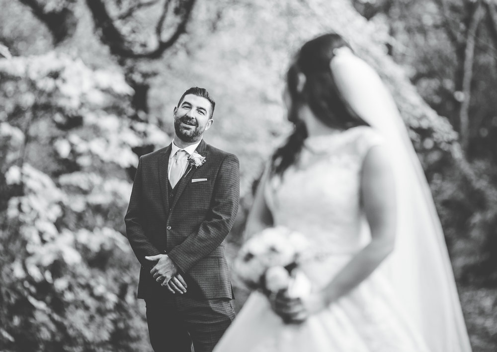 bride looking at the groom - modern wedding photography in Manchester