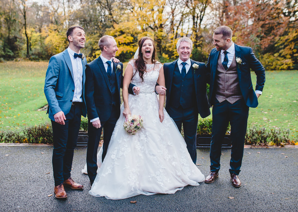 bride laughing with her brothers