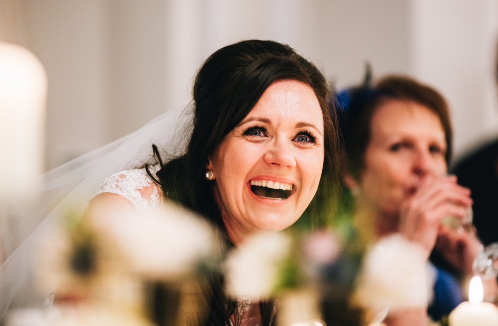 bride laughs during the speeches at Ashfield House - wedding photographer Manchester