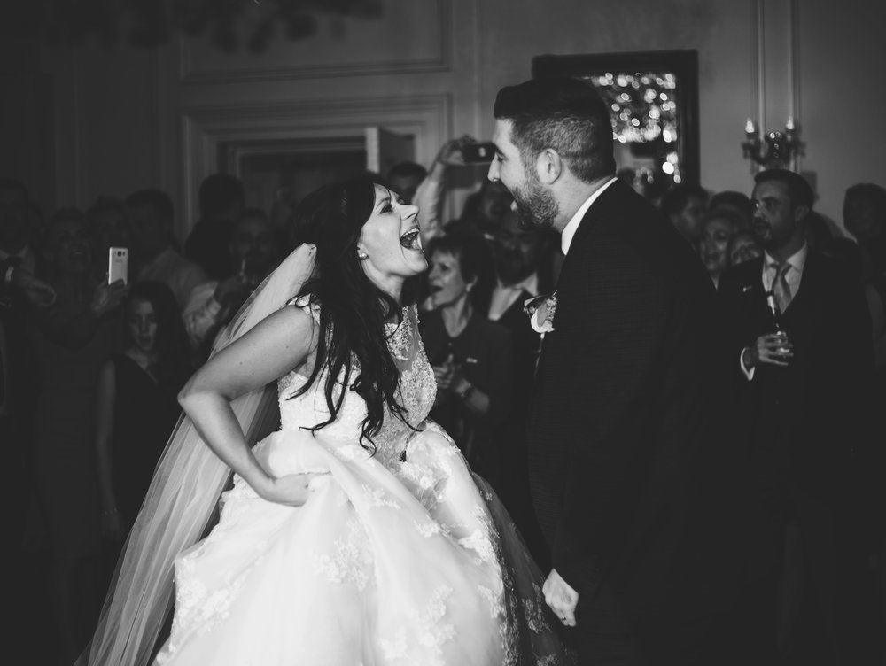 bride and groom laughing and dancing - wedding photographer in manchester