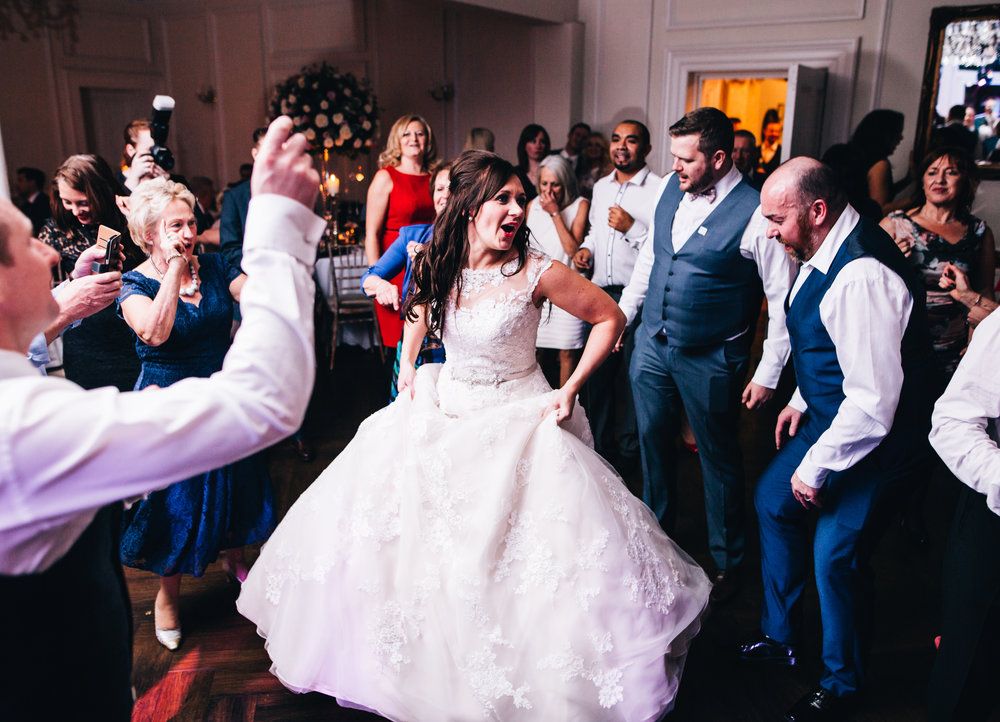 bride and groom dance surrounded by their guests at Ashfield House wedding