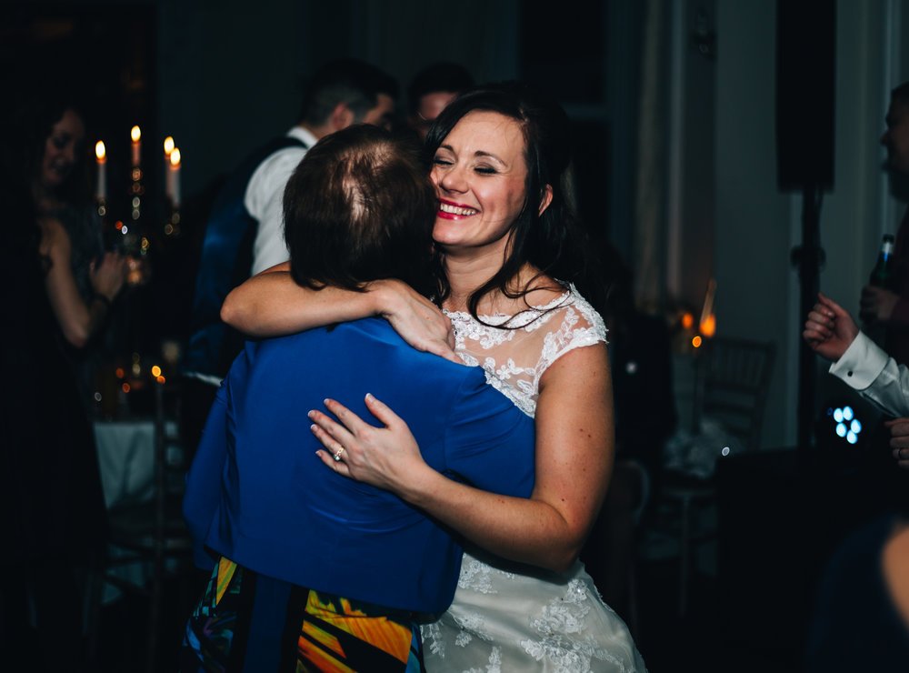 bride hugs her mother - emotional documentary wedding photography in Lancashire